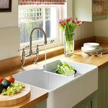green kitchen sinks sink area step inside this traditional soft green kitchen reader