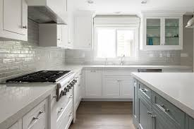 white and gray kitchen features white perimeter cabinets paired
