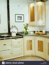 cream aga in modern cottage kitchen with granite worktops on pale