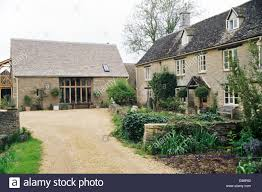 large country farmhouse with adjacent barn conversion stock photo