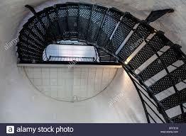 underside of spiral stairway and intermediate metal platform in
