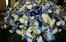 blue and white tribute casket spray cress floral decorators