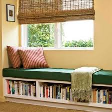 Bookcase Under Window With Wooden Bench For Seating Pillow On It