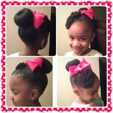 twisted bun hairstyle on african american bun with rope twist bangs shared by shaneria mosley http