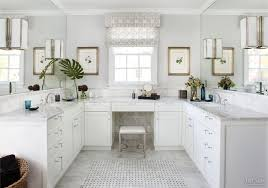traditional white bathroom with carrara marble vanity tops marble
