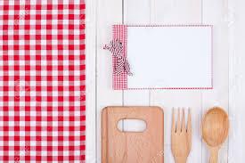 fonds de cuisine recipe cook book kitchen equipment on white wood background stock