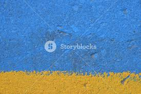 colors close to yellow vivid blue and yellow painted rough concrete wall or floor texture