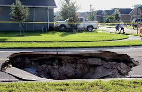 Map Of Sinkholes In Florida 30 foot deep hole opens in road at holiday subdivision tbo com