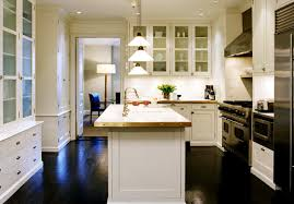 white kitchen cabinets with wood floors cottage kitchen
