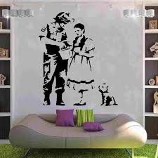 banksy migration from banksy on your wall it s possible banksy police officer inspects dorothy