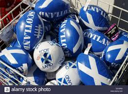 novelty small scotland rugby balls on display outside of a
