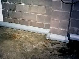 Covering Concrete Walls In Basement by Baseboard Basement Drain Pipe System In Greater Louisville Homes