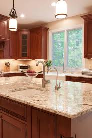 what backsplash looks with cherry cabinets best bordeaux granite kitchen countertops design ideas
