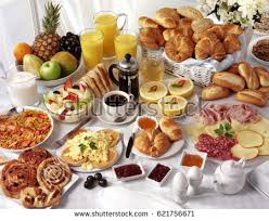 breakfast table breakfast table filled assorted foodssavourysweetpastrieshot cold