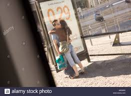 lovers kissing at at bus stop i in porto portugal credit geraint