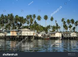 village stilt houses built over sea stock photo 53877982