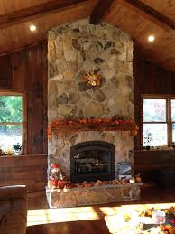 reclaimed wood products the stone shop mountain stone fireplace barn beam mantle with stone hearth