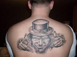 realistic leprechaun tattoo on upper back