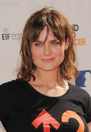 womens haircuts for strong jaw emily deschanel medium hairstyle with layers and bangs for a