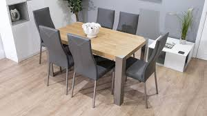 modern oak veneer dining table real leather high backed chairs