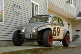 baja jeep cherokee old parked cars 1970 volkswagen beetle baja bug