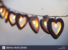heart shaped christmas lights heart shaped string lights hanging in a row stock photo 135828523