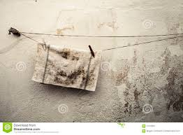old dirty rag hanging on a wire antique wall background stock royalty free stock photo
