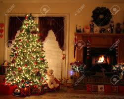 Lighted Christmas Trees Home With Lighted Christmas Tree Presents Fireplace Stockings