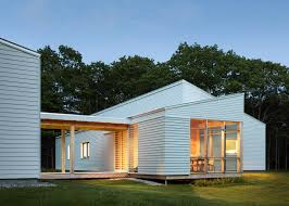 how to go about building a house logic builds a wooden house in a forest clearing in maine