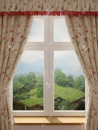window with a wonderful view of the village and decorating in