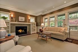 traditional living room with stone fireplace wall sconce in with