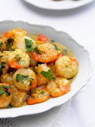 comment cuisiner les crevettes congel馥s crevettes au four huile d olive ail et persil une plume dans la