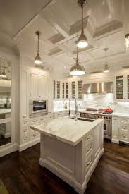white cabinets grey walls neutral backslash dark island design