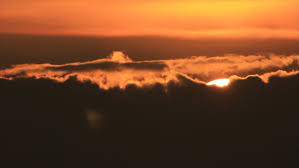 bright sun drops in clouds on the sunset sky stock footage