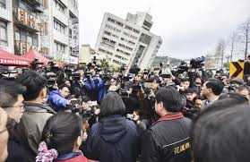 earthquake update taiwan earthquake rescuers scour tilting buildings after seven