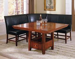 square brown wooden dining table and l shaped black leather bench