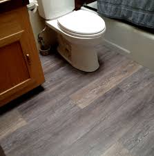Vinyl Plank Flooring In Bathroom Flooring Interesting Bathroom With White Toilet And Mocha Wood
