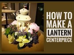 lantern centerpieces how to create a lantern centerpiece using artificial flowers