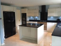 Espresso Cabinets With Black Appliances Decorating With Black Kitchen Appliances Sicis Iridized Glass