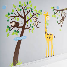 giraffe picture with monkeys in the trees with it leaves in green
