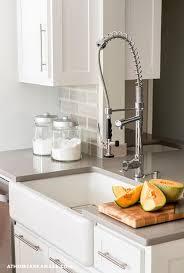 White Cabinets With Grey Quartz Countertops White Kitchen Cabinets With Gray Quartz Countertop And Gray Subway