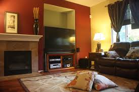 house modern family room wall decorating ideas with red curtains