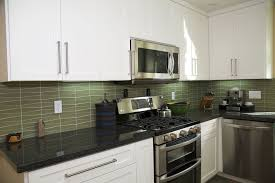 How To Install A Glass Tile Backsplash In The Kitchen Waveline Glass Tile Reflects The Flowing Feel Of Water