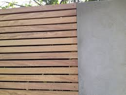 iroko horizontal trellis detail with rendered wall barrier wall