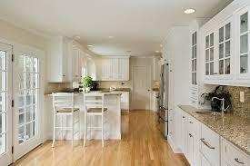 white kitchen cabinets with oak floors ammarati kitchen