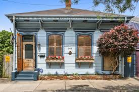 marigny double shotgun with a spacious screened porch asks 440 5k