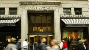 why is saks fifth avenue owner buying a struggling german retailer