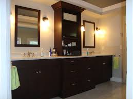 double black wooden vanity with glass vessel sinks bathroom
