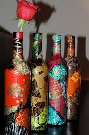 modge podge scrap book paper onto an old bottle of any size shape