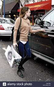 emma roberts shopping for christmas gifts along santa monica stock